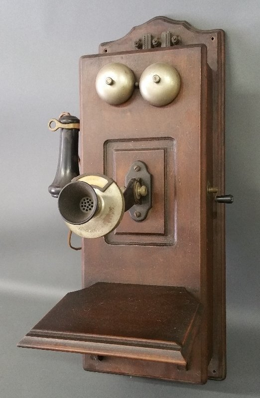 Walnut wall phone with crank.  25 inches high, 9 ½