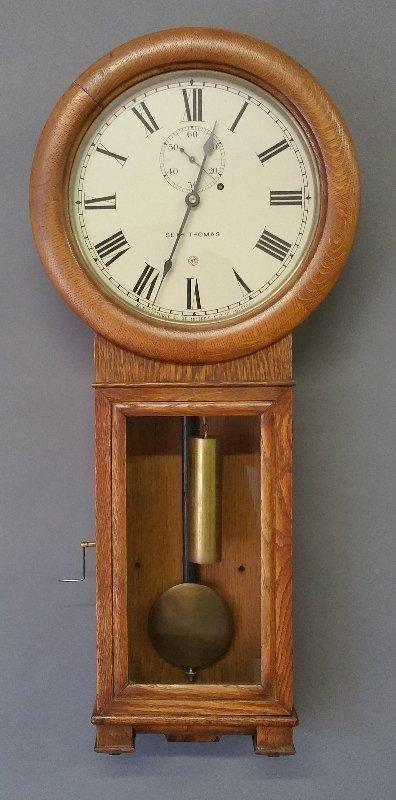Seth Thomas oak cased No. 2 regulator wall clock.  35