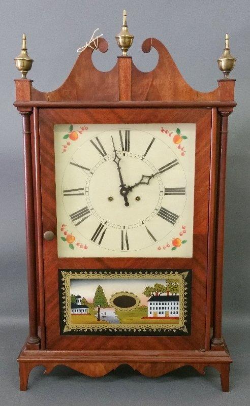 Pillar and scroll style mahogany clock made by Natt