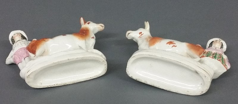 A pair of Staffordshire milkmaid and milkman/cow - 2