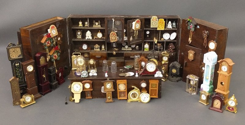 Miniature room setting of a clock shop of various