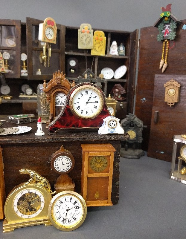 Miniature room setting of a clock shop of various - 2