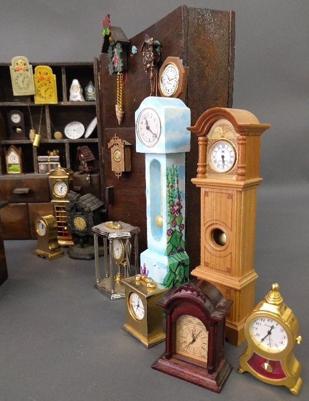 Miniature room setting of a clock shop of various - 3