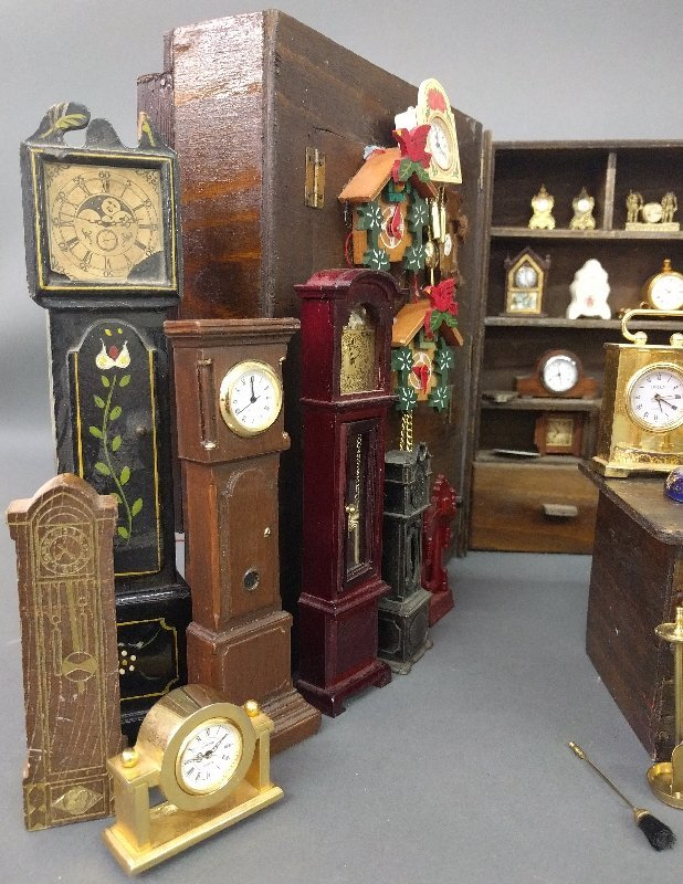 Miniature room setting of a clock shop of various - 4