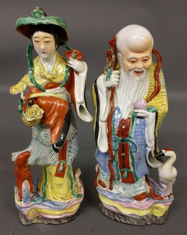 Pair of Asian porcelain figures. 14 inches high.