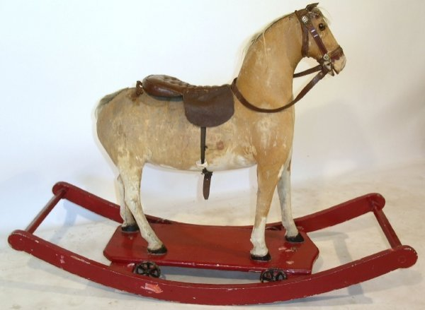 26: Stuffed hide rocking horse, late 19th c., on a wood
