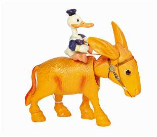 Donald Duck Donkey Jockey Wind-Up Toy.