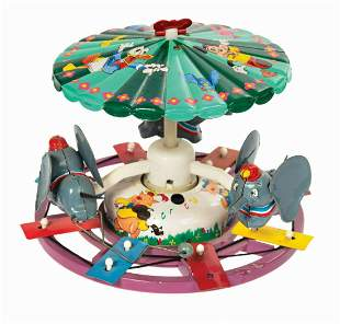 Marx Dumbo Musical Mechanical Merry-Go-Round Tin Toy.