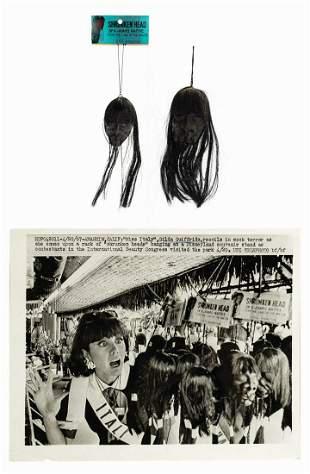 Pair of Souvenir Shrunken Heads.