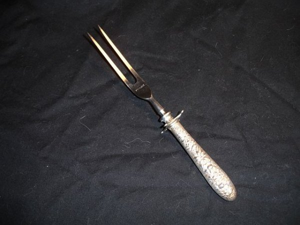 122: Hennegan Bates Sterling Repousse Carving Fork