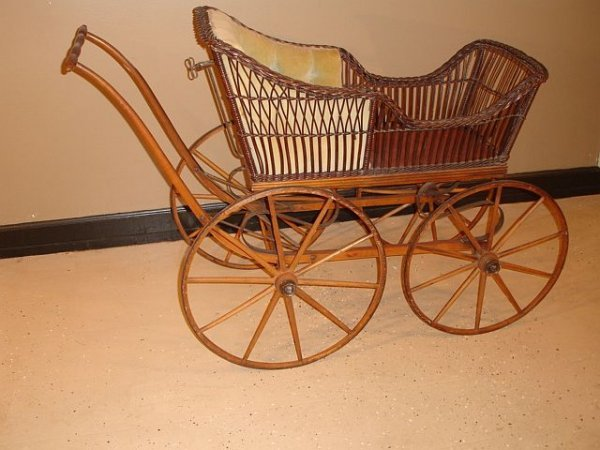 125: Antique Large Wheel Wicker Baby Carriage