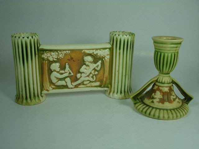 12: Two Roseville Donatello candle holders