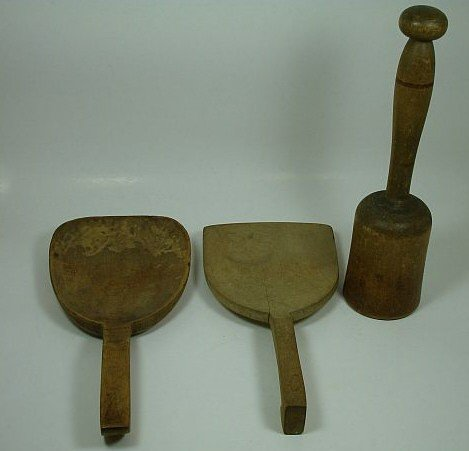 13: Two dough paddles and pestle