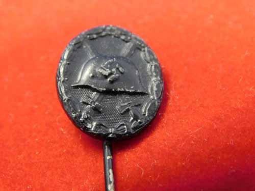 Nazi stick pin - helmet over crossed swords