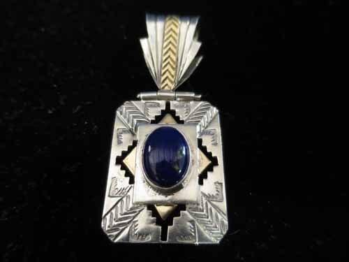 14k and Sterling pendant with blue stone, signed.