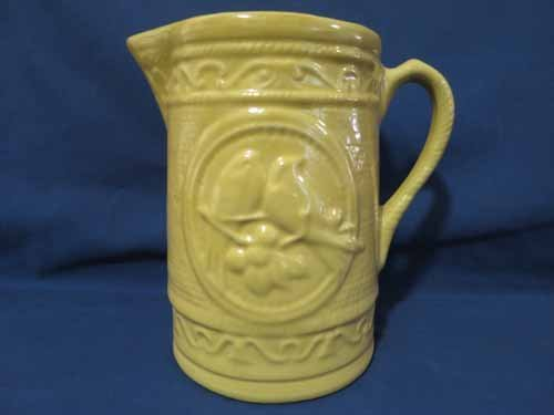 Clay City floral tan pottery pitcher, 8x8 in.