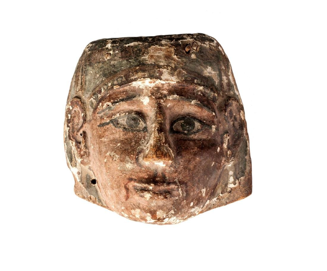A Late Period Egyptian wood mask from a coffin,