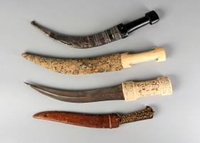 Three Qajar daggers, Iran, 19th century, one with a