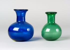 A blue glass bottle, Safavid, and a green glass bottle,