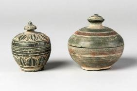 Two Gandharan grey schist lidded cosmetic containers,