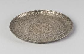 A Mughal silver circular dish, 17th century, worked to