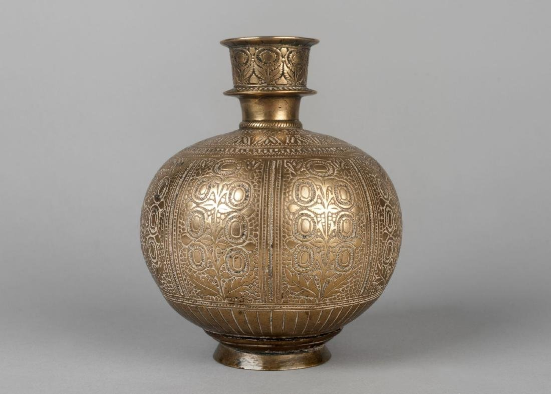 A brass hookah base, India, 18th century, of globular