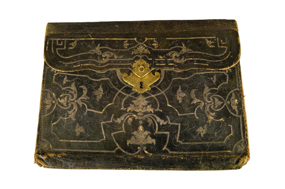 An unusually large Ottoman embroidered brown leather