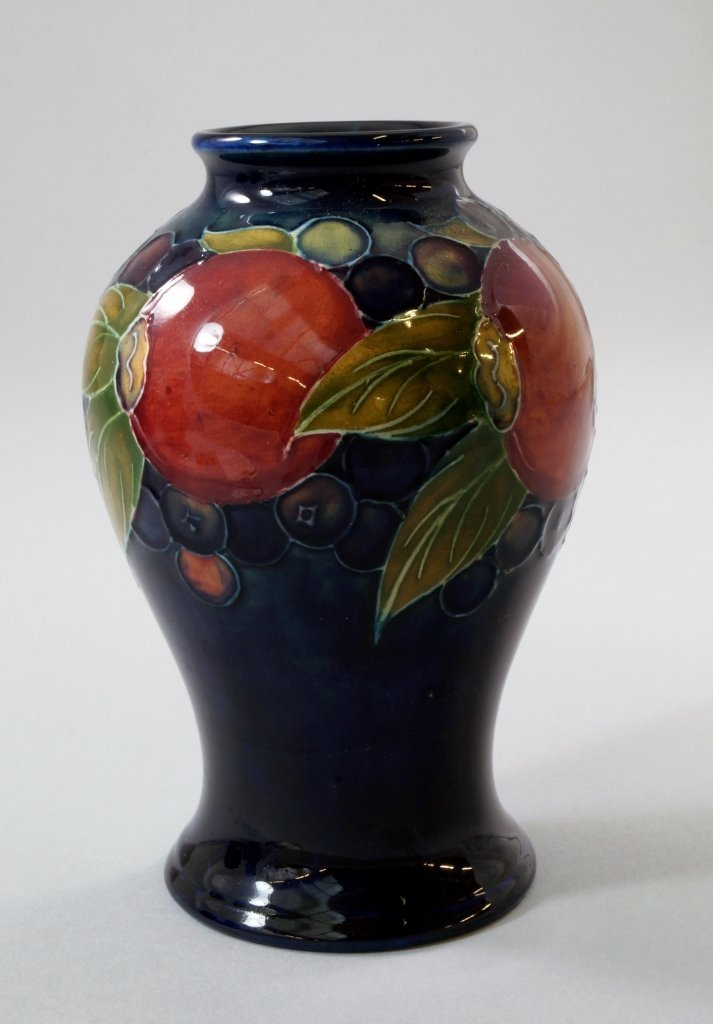 'Pomegranate', a Moorcroft baluster vase designed by