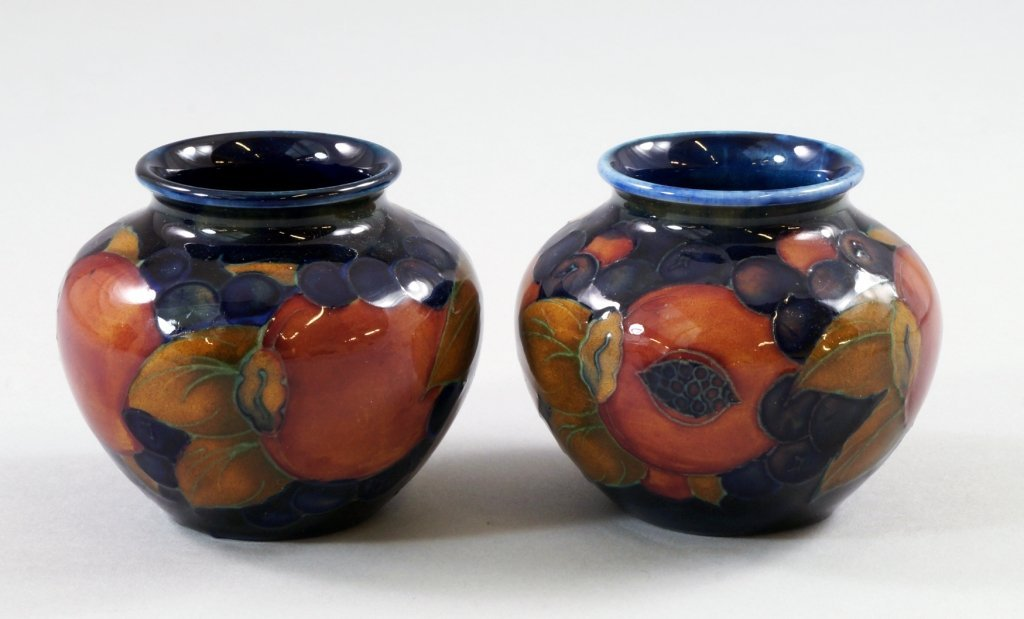 'Pomegranate', a pair of Moorcroft vases, painted with