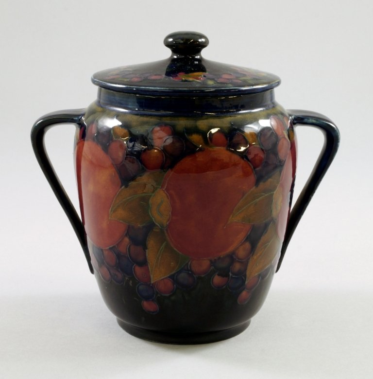 'Pomegranate', a Moorcroft biscuit barrel by William