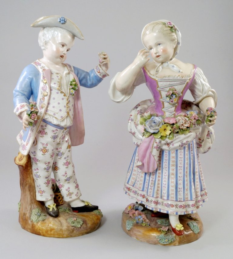 A pair of Meissen figures of a boy and girl, late 19th