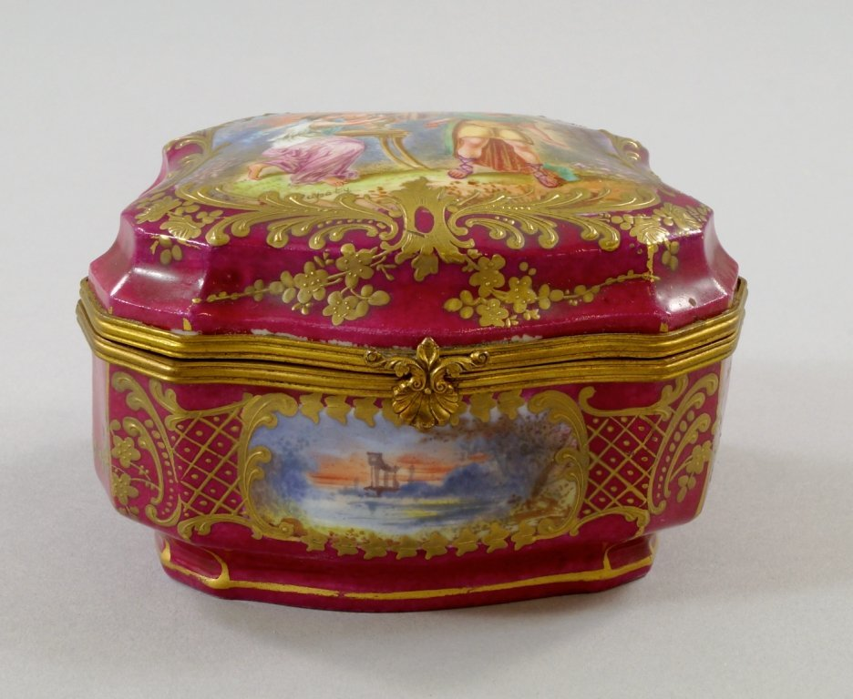 A Continental porcelain box, 19th century, of shaped