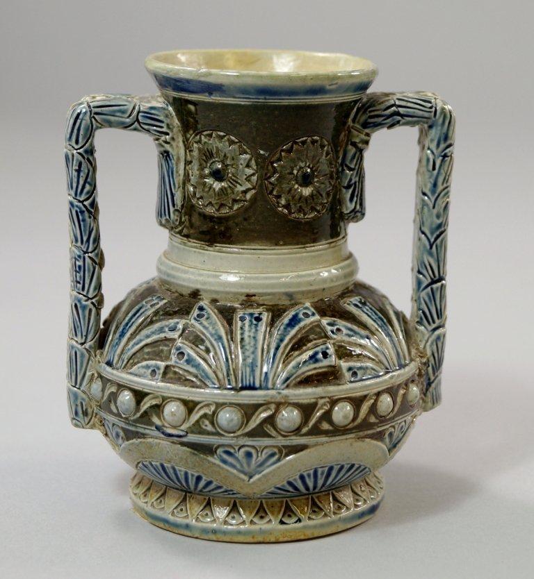 A Martinware twin handled stoneware vase, of globular