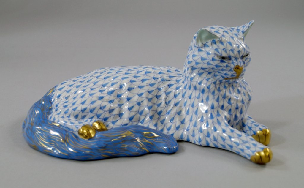 A Herend model of a cat, painted and gilded, printed