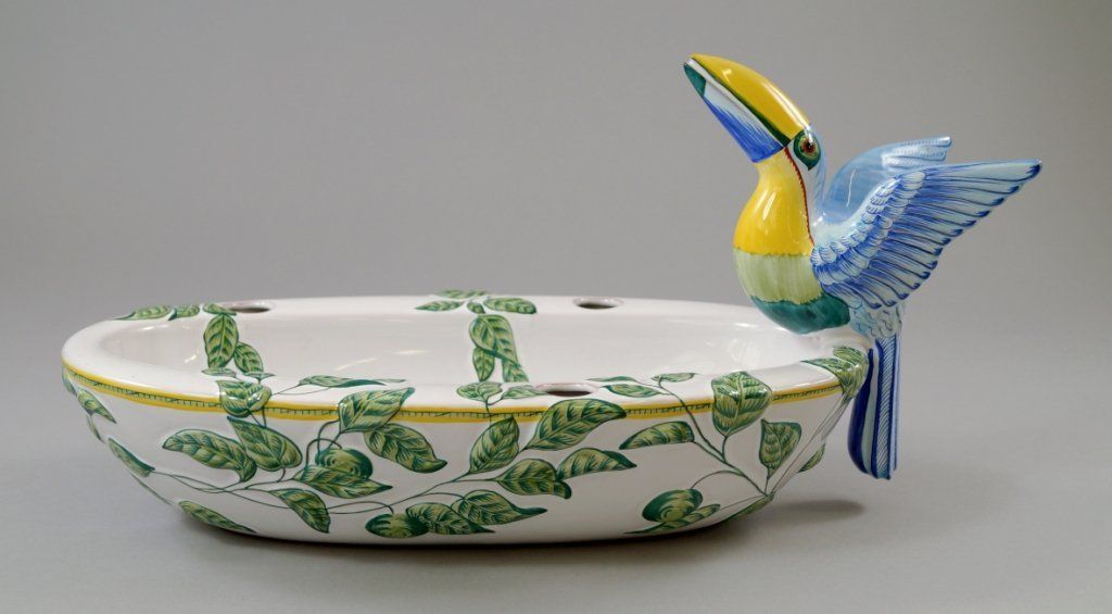 An Hermes oval faience dish, with a toucan handle,