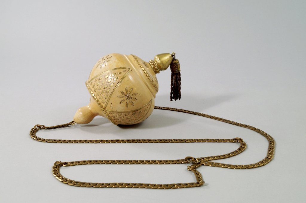 A Turkish terracotta gourd ornament, with inlaid gilded
