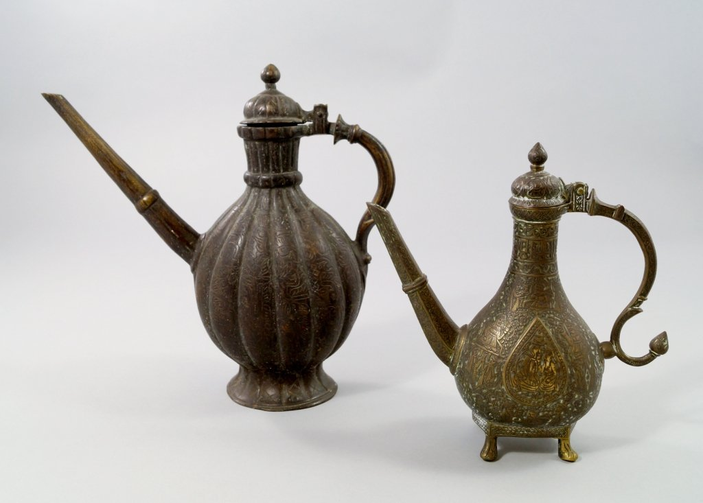 An Islamic bronze ewer, 19th century, central figural