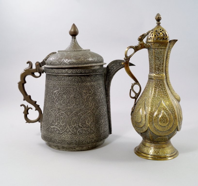 An Islamic white metal ewer, overall decorated with