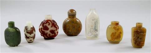 A Chinese overlaid glass snuff bottle the red raised