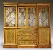 A large Edwardian inlaid mahogany breakfront bookcase,