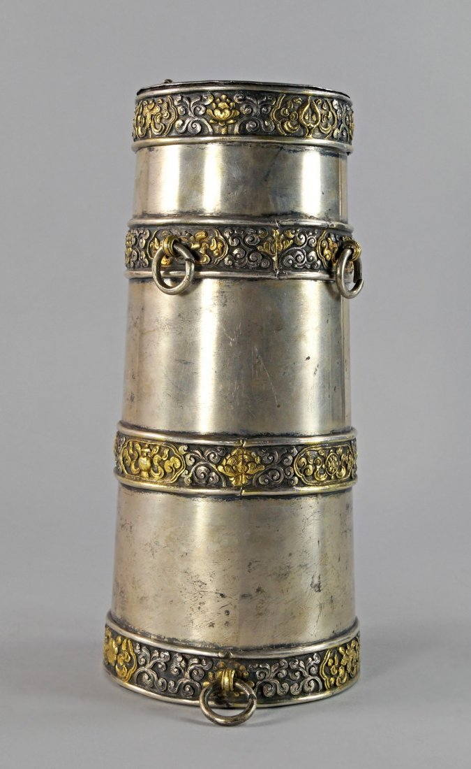 A Tibetan white metal and gilt powder flask, of