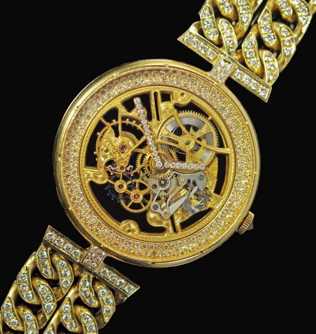 A Fine and Unique 18ct gold and diamond set gentleman's