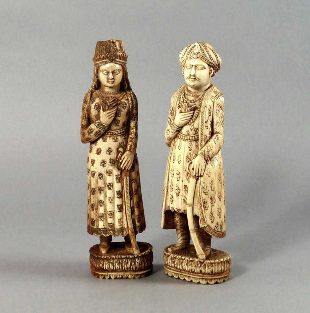 A pair of Indian ivory figures, 19th century, each