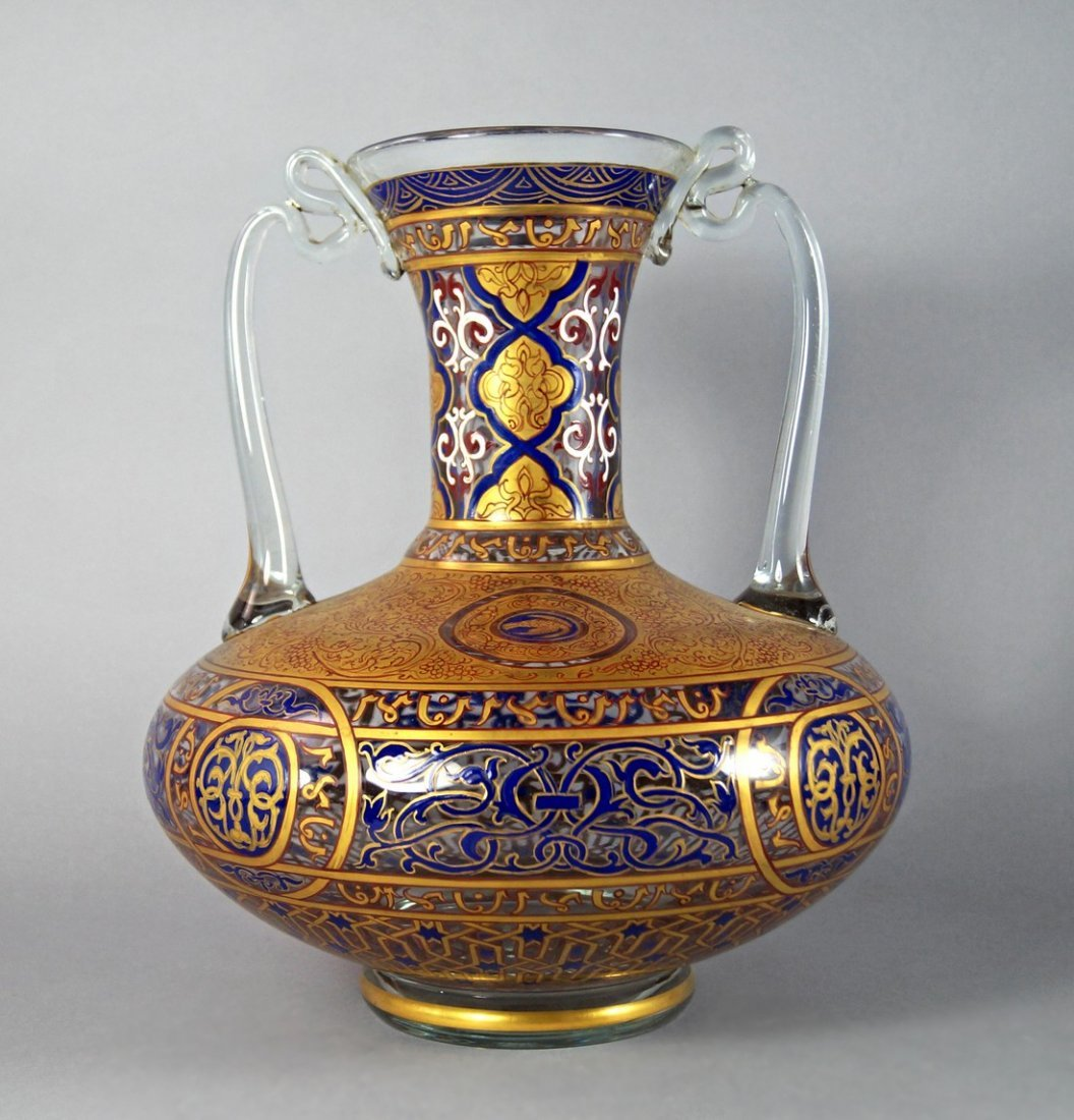 A Mamluk style gilt decorated and enamelled twin