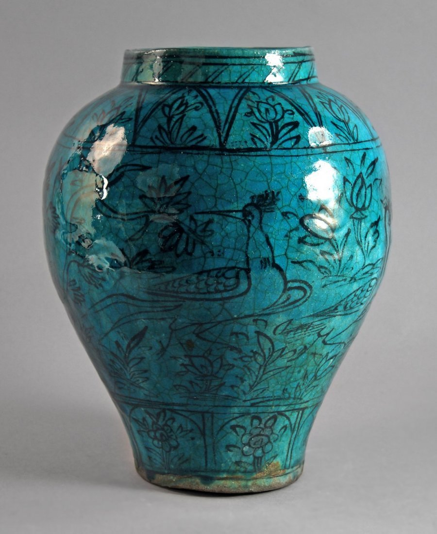 A Kashan style turquoise glaze earthenware vase, 19th