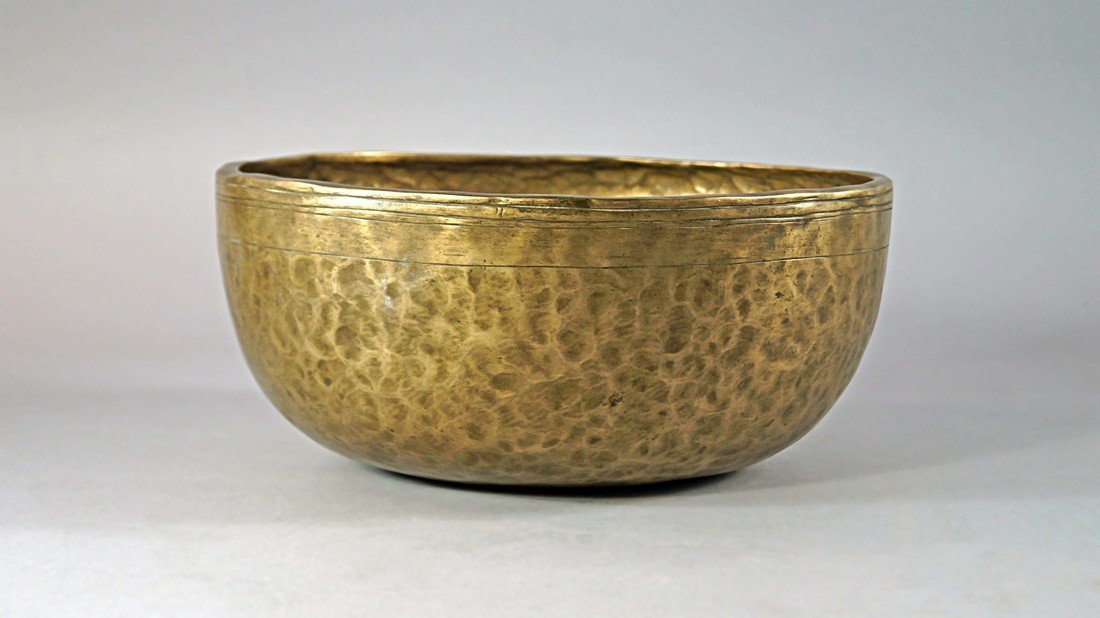 An Islamic brass bowl, possibly 17th/18th century, of
