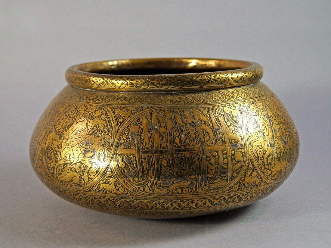 A Persian brass and silver line inlaid bowl, 19th