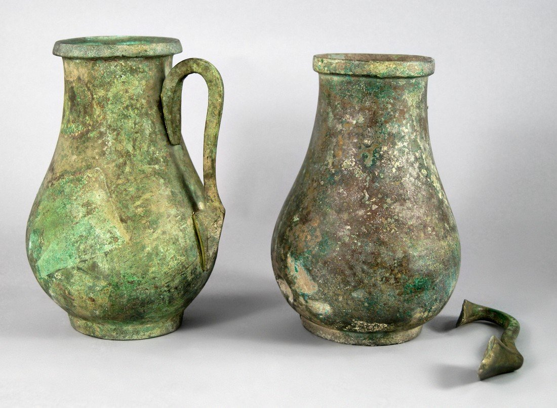A pair of Near Eastern bronze baluster jugs, possibly