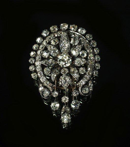 An impressive diamond set double pronged fur clip,
