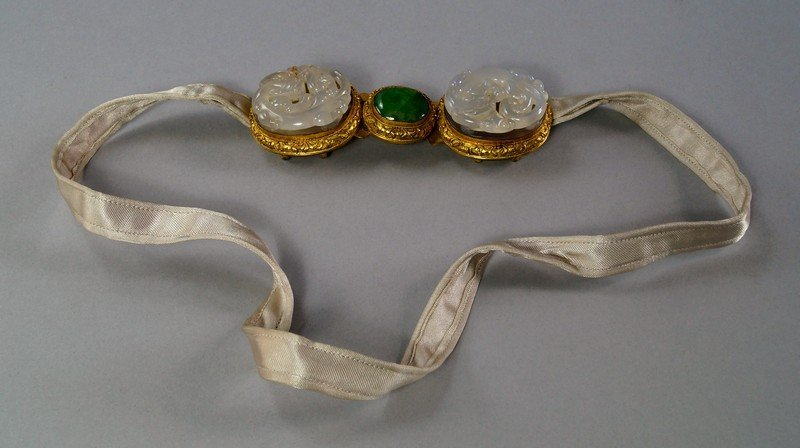 A Chinese gilt metal belt buckle, late 19th/20th